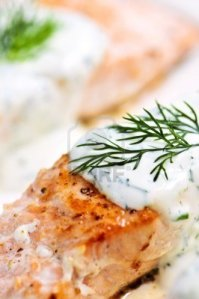 salmon-fillets-with-dill-sauce-on-white-plate